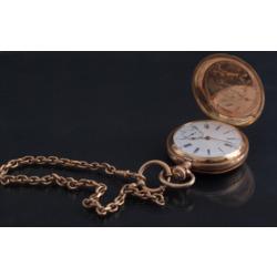 Zelta kabatas pulkstenis ar ķēdi