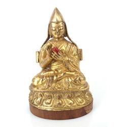 Zeltītas bronzas figūra