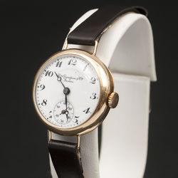 Zelta rokas spulkstenis ar ādas siksniņu David Henry Grandjean & Co