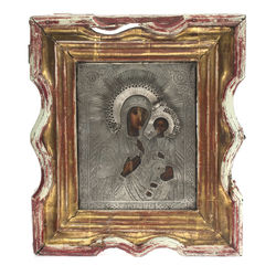 Silver icon in the wooden frame