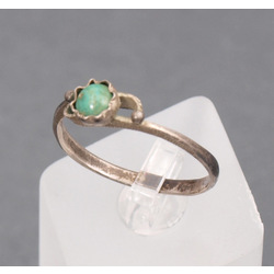 Silver ring with green stone
