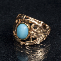 Golden ring with a blue stone