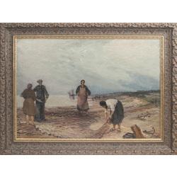 Zvejnieki jūras krastā