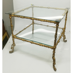 Glass table with bronzed metal finish