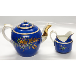 Teapot with cream dish