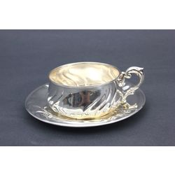 Silver mug with saucer in Baroque style