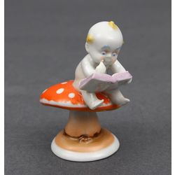 Porcelain figurine Boy on the mushroom