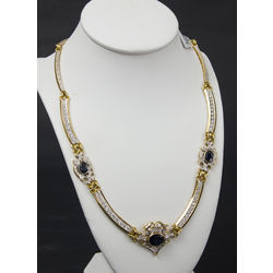 Gold necklace with diamonds and sapphires