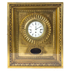 19th century wall clock with carved and gilded frame