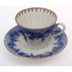 Porcelain mug with saucer