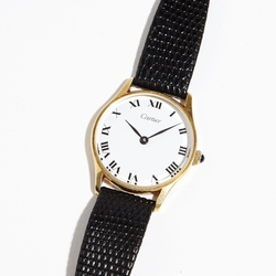 French Cartier gold watch with leather strap