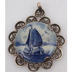 Porcelain pendant in silver frame