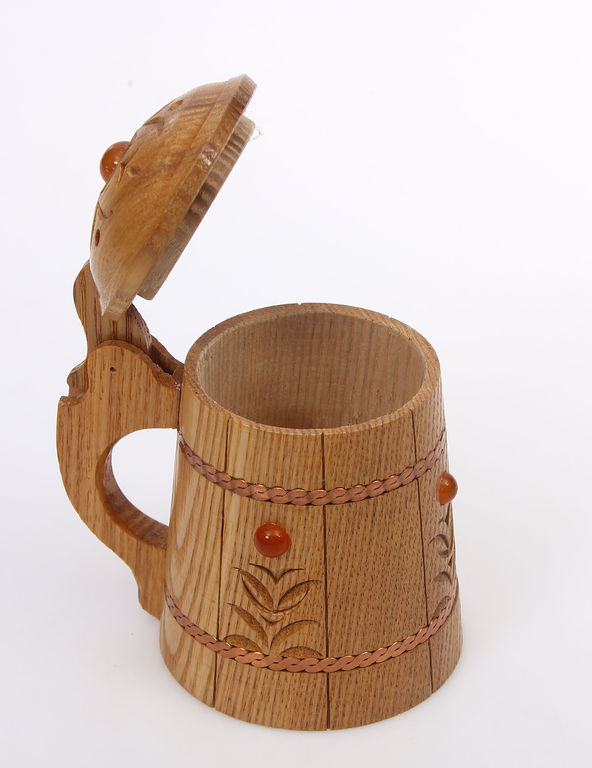 Wooden cup with melted amber