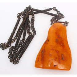 Amber pendant with metal chain