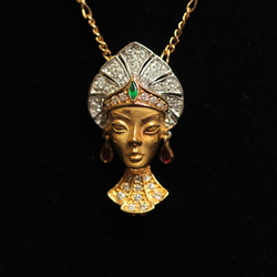 Gold necklace with brilliants, emeralds, rubies
