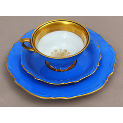 Porcelain cup with two saucers
