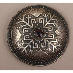 Silver brooch with red stone and Latvian signs