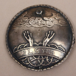 Silver brooch with white stone