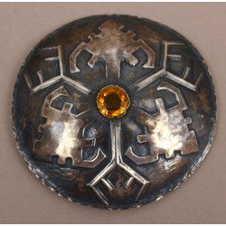 Silver brooch with yellow stone