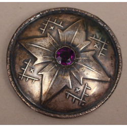 Silver brooch with purple stone