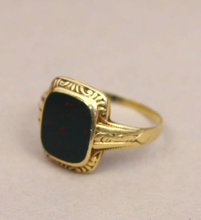 Gold ring with black stone