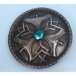 Silver brooch with blue stone