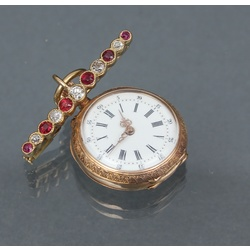 Gold watch with brooch