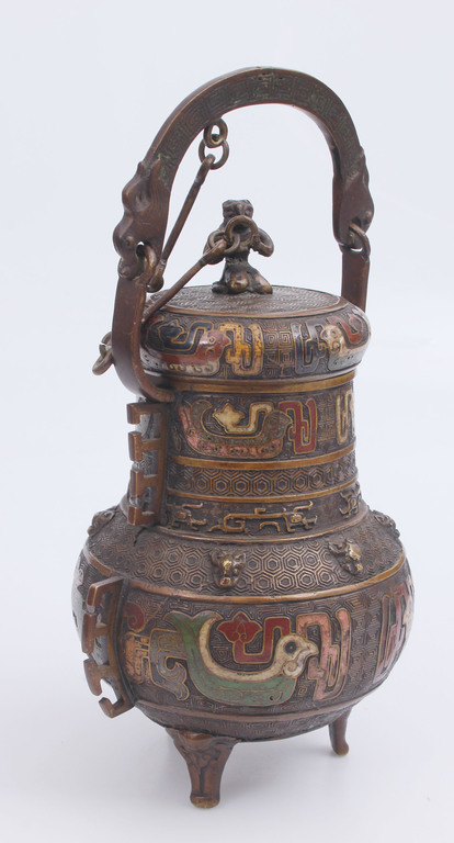 Bronze can with multi-colored enamel
