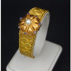 Zelta sieviešu rokaspulkstenis