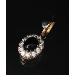 Gold pendant with zircons and black onyx