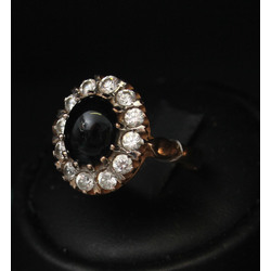 Gold ring with zircons and black onyx