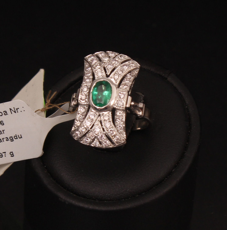 Gold ring with diamonds and emeralds