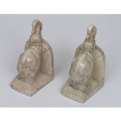 A pair of faience book holders