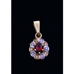 Gold pendant with diamonds and garnet
