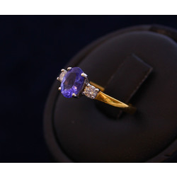 Golden ring with diamonds and topaz