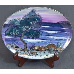 Apgleznots porcelana šķīvis