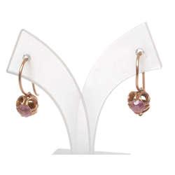 Zelta auskari ar rozā akmeni