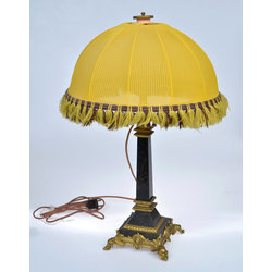 Table lamp with a yellow dome