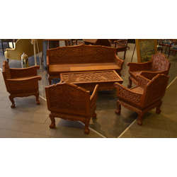 Mahogany table and chairs with wood carvings